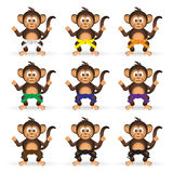Cute chimpanzee set with karate training color belts little monkey  eps10 Royalty Free Stock Photos