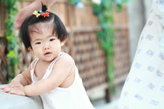 Cute Chinese baby girl learn how to walk Royalty Free Stock Photo