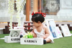 Cute Chinese baby girl play in a garden Royalty Free Stock Photo