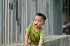 Cute Chinese boy playing. Half body portrait of cute Chinese boy playing outdoors Royalty Free Stock Photos