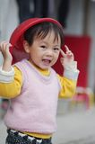 Cute chinese girl. Playing with a plastic basket Royalty Free Stock Photos