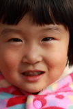 Cute Chinese girl in winter. Time portrait Royalty Free Stock Photo