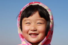 Cute Chinese girl in winter. Time portrait Royalty Free Stock Image