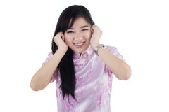 Cute chinese lady closing her ears Royalty Free Stock Image