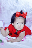 Cute Chinese little baby in red cheongsam have fun Stock Photography