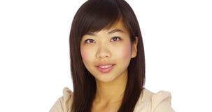 Cute Chinese woman smiling at camera Royalty Free Stock Photography