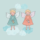 Cute Christmas angel with bell in cartoon style. Hand drawn cute Christmas angels with bells in cartoon style.  vector illustration on blue background with Royalty Free Stock Photography