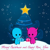 Cute Christmas angel and devil Stock Photo