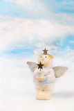 Cute christmas angel with a star in his hands. Idea for a greeti Royalty Free Stock Photos