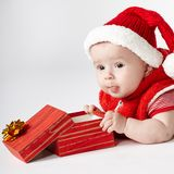 Cute christmas baby with gift Royalty Free Stock Photo