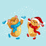 Cute Christmas bears during the winter holidays and the New Year`s Eve jump under snowfall rejoice gifts. Stock Images