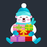 Cute Christmas bears during the winter holidays and the New Year s Eve sitting rejoice gifts. Teddy in clothes warm Stock Image