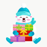 Cute Christmas bears during the winter holidays and the New Year`s Eve sitting rejoice gifts. Teddy in  clothes warm Royalty Free Stock Photo