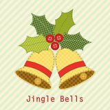 Cute Christmas bells with holly berry as retro fabric applique in shabby chic style Royalty Free Stock Photos