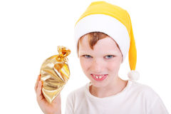 Cute christmas boy with a gift Stock Photos