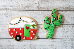Free Cute Christmas Camper And Cactus Decorated Sugar Cookies Stock Images - 129676324