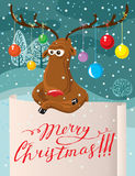 Cute Christmas card. Cartoon deer with paper banner Royalty Free Stock Photography