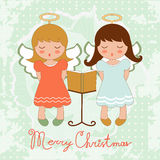 Cute Christmas card with happy angels singing Stock Photography
