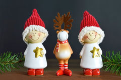 Cute Christmas card. With little elves and reindeer Stock Photo