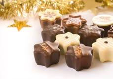 Cute christmas chocolates royalty free stock photography