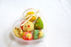 Cute Christmas Cookies in the Heart shape Plastic Box. Cute Christmas Cookies in the Heart shape Plastic Box on the white table Royalty Free Stock Images