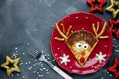 Cute Christmas food idea - funny reindeer pancake. Top view royalty free stock photos