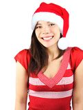 Cute Christmas Girl. Santa girl. Cute shy smiling mixed asian / caucasian young woman with christmas hat. Isolated on seamless white background Royalty Free Stock Photo