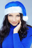 Cute christmas girl. Potrait of cute girl wearing blue christmas costume Royalty Free Stock Photography