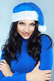 Cute christmas girl. Potrait of cute girl wearing blue christmas costume Stock Image