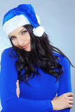 Cute christmas girl. Potrait of cute girl wearing blue christmas costume Stock Photography