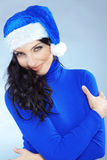 Cute christmas girl. Potrait of cute girl wearing blue christmas costume Royalty Free Stock Photo