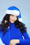 Cute christmas girl. Potrait of cute girl wearing blue christmas costume Royalty Free Stock Images