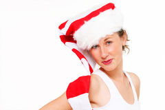 Cute Christmas girl. In santa cap, background with text space Royalty Free Stock Photos