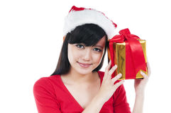 Cute Christmas Girl Holding Gift Box. Portrait of a beautiful Christmas woman holding a gift box against white background Royalty Free Stock Photography