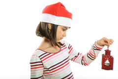 Cute Christmas girl with lantern. Cute little girl with Santa hat holding a red lantern Stock Images