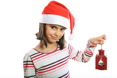 Cute Christmas girl with lantern. Cute little girl with Santa hat holding a red lantern smiling Royalty Free Stock Photos