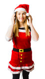 Cute christmas girl listening to holiday music Stock Photos