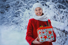 Cute Christmas girl. Christmas girl outdoor portrait. Cute teens girl in snow park with gift Stock Image