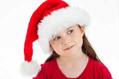 Cute Christmas Girl. Portrait of a little girl wearing a Christmas Hat, head tilted looking to the side Royalty Free Stock Photo