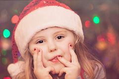 Cute Christmas girl portrait. Cute Christmas girl with the Christmas tree lights bokeh in the background Royalty Free Stock Photo