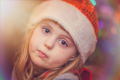 Cute Christmas girl portrait. Cute Christmas girl with the Christmas tree lights bokeh in the background Royalty Free Stock Photography