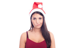 Cute Christmas Girl. In Santa Claus hat Royalty Free Stock Images