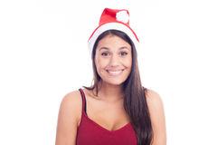 Cute Christmas Girl. In Santa Claus hat Stock Photos
