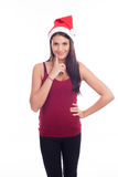 Cute Christmas Girl. In Santa Claus hat Royalty Free Stock Photography