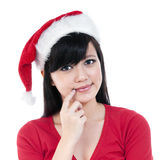 Cute Christmas Girl Thinking. Portrait of a beautiful Christmas woman thinking isolated on white background Royalty Free Stock Photos