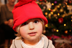 Cute Christmas girl. With the Christmas tree in the background Stock Images