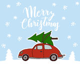Cute Christmas greeting card, invitation with red vintage car transporting the Christmas tree on the roof. Snowy winter Stock Photo