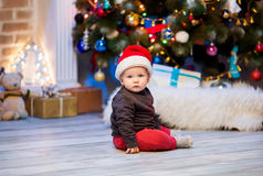 Cute christmas little baby child boy among Christmas decorations Stock Photo