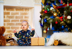 Cute christmas little baby child boy among Christmas decorations Royalty Free Stock Image