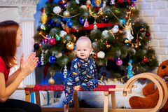 Cute christmas little baby child boy among Christmas decorations Stock Photos